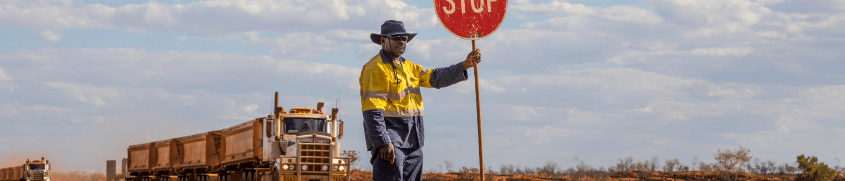 1 male worker outback Australia with stop sign